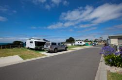 Enjoy spacious caravan and camping sites set up under the blue sky