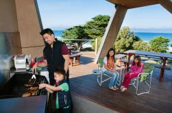 Cook family and group dinners in our undercover BBQ areas with stunning views